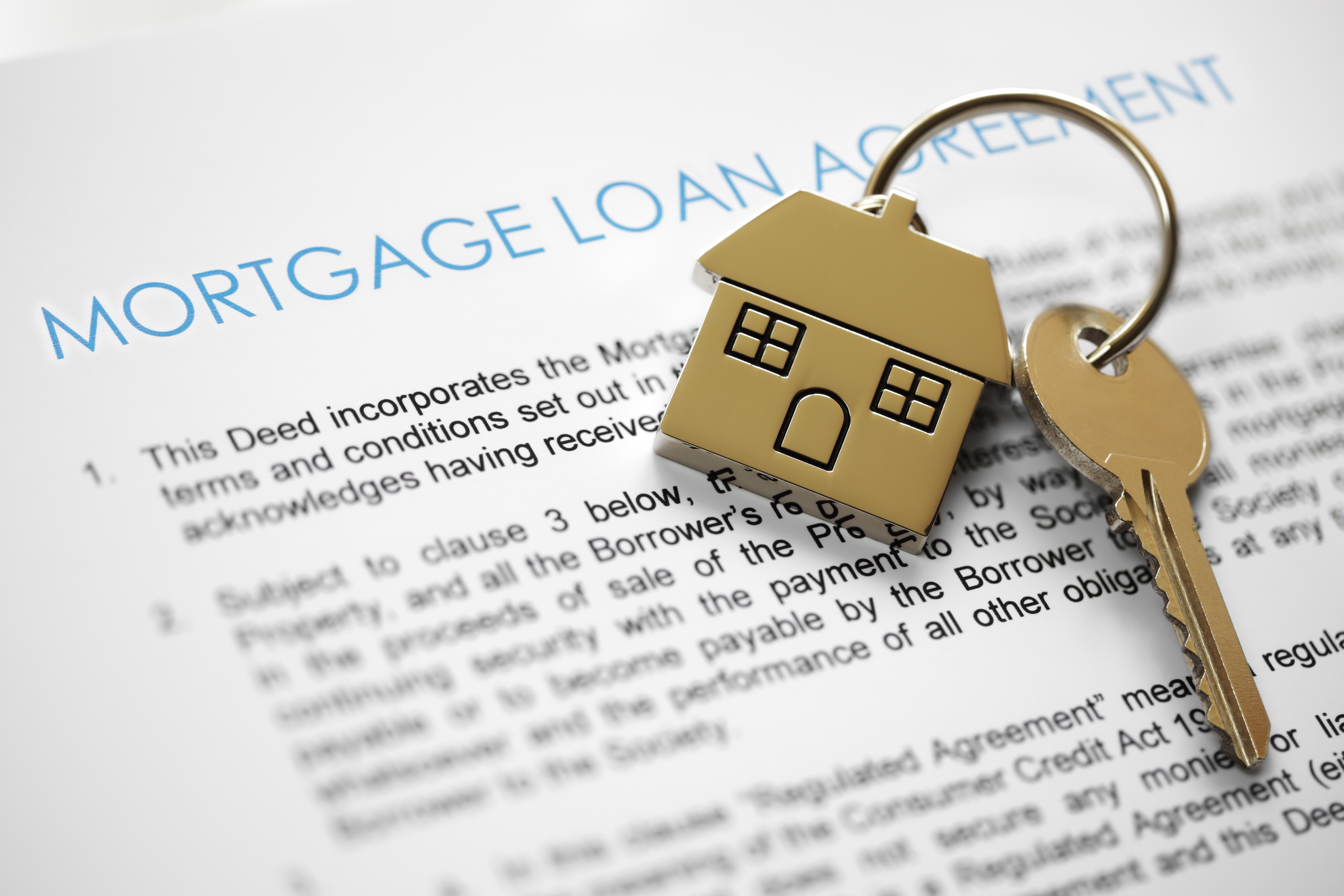House keys over mortgage loan document