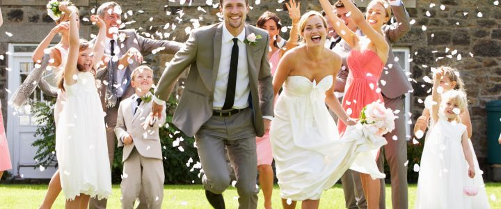 Newly-wed couple running happily