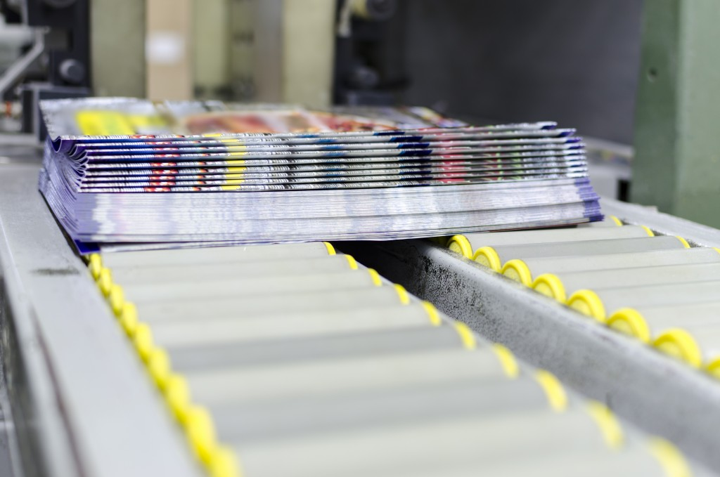 set of brochures being printed in a factory
