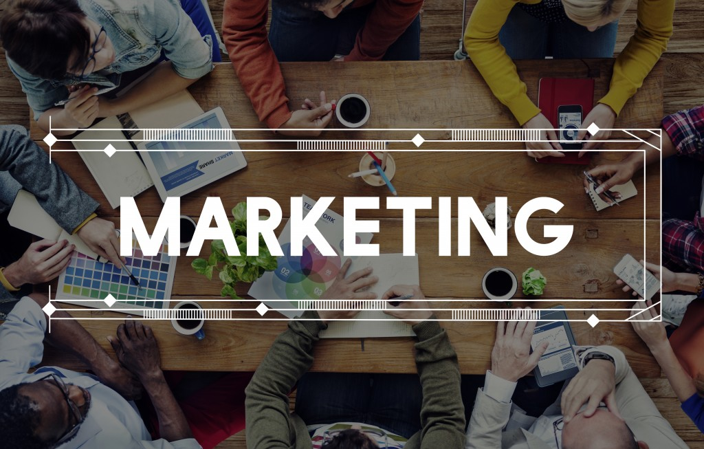 marketing text design with people meeting in the background