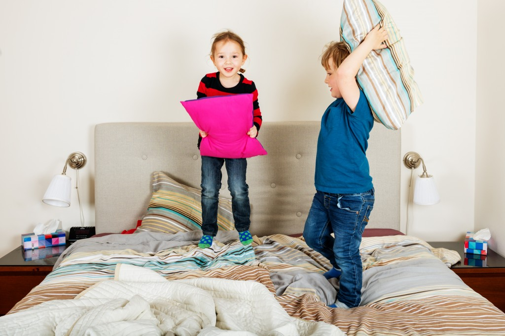 two children playing in their bedroom