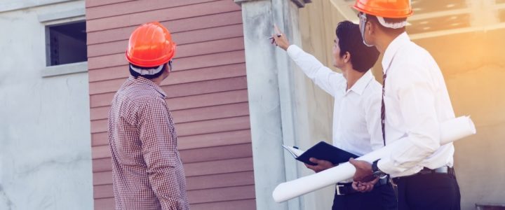 photo of home inspectors wearing orange hard hat