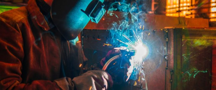 a man working using his welding equipment