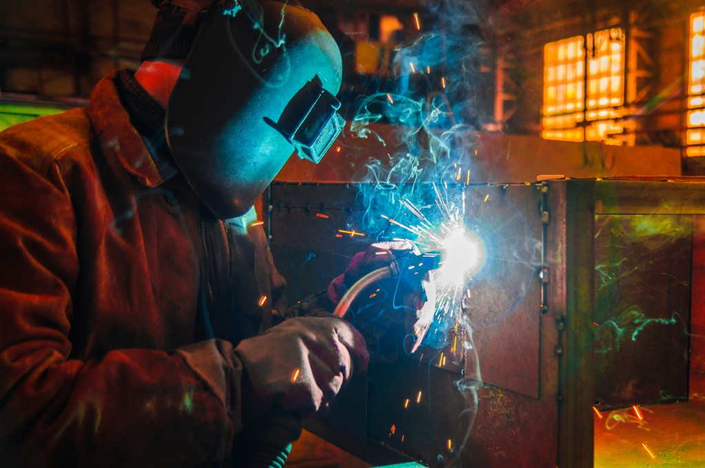 a man working using his welding equipment