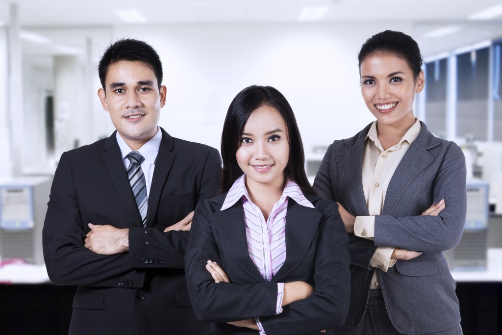 Filipino employees posing in the office
