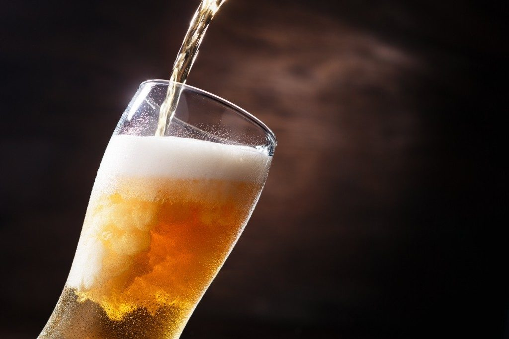Beer pouring in a glass