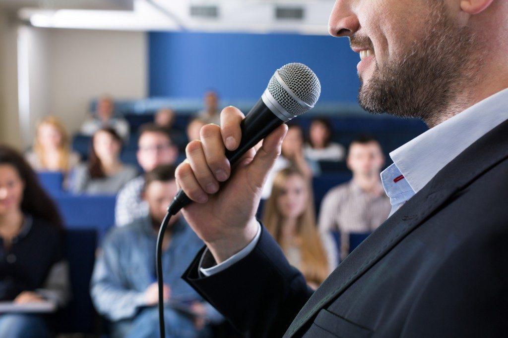 Man in suit speaking doing a speech