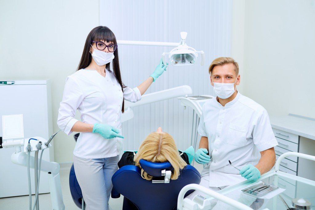 Dental clinic with patient and dentist