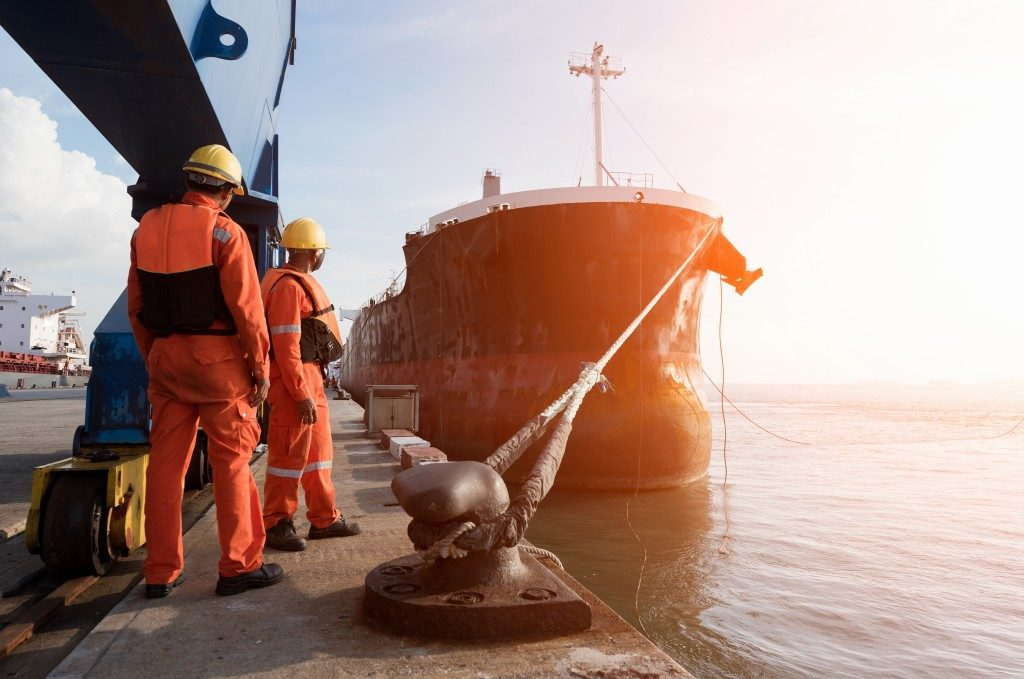Workers waiting for the cargo ship to dock