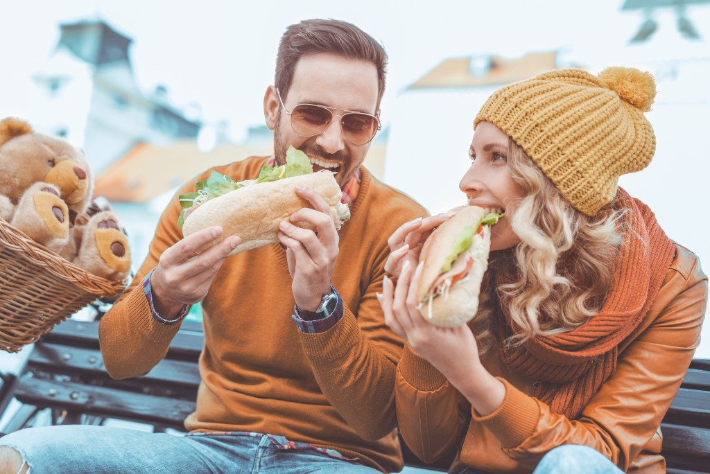 Couple eating a sandwich
