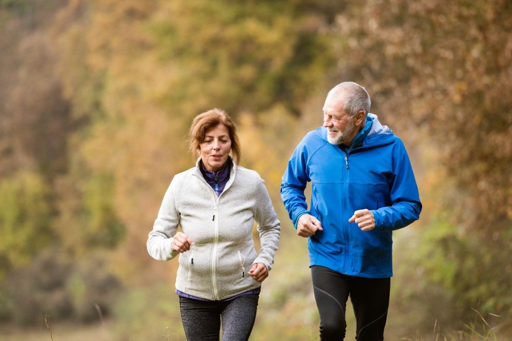 retired couple enjoying a run
