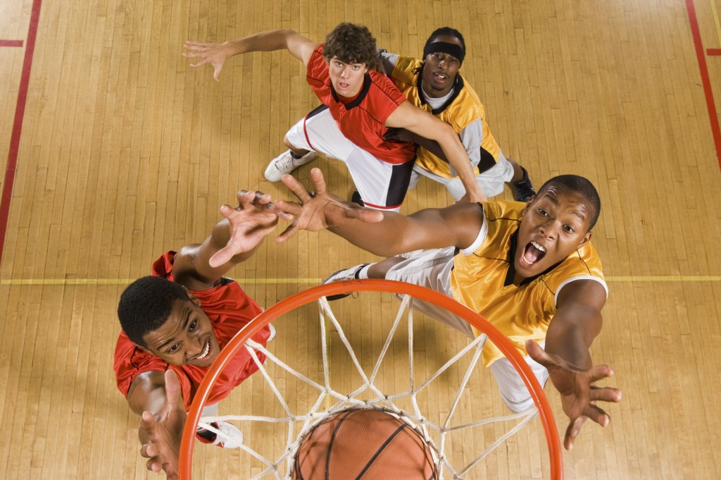 Basketball players fighting for the ball