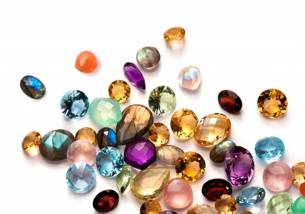 Collection of many different natural gemstones on the white background