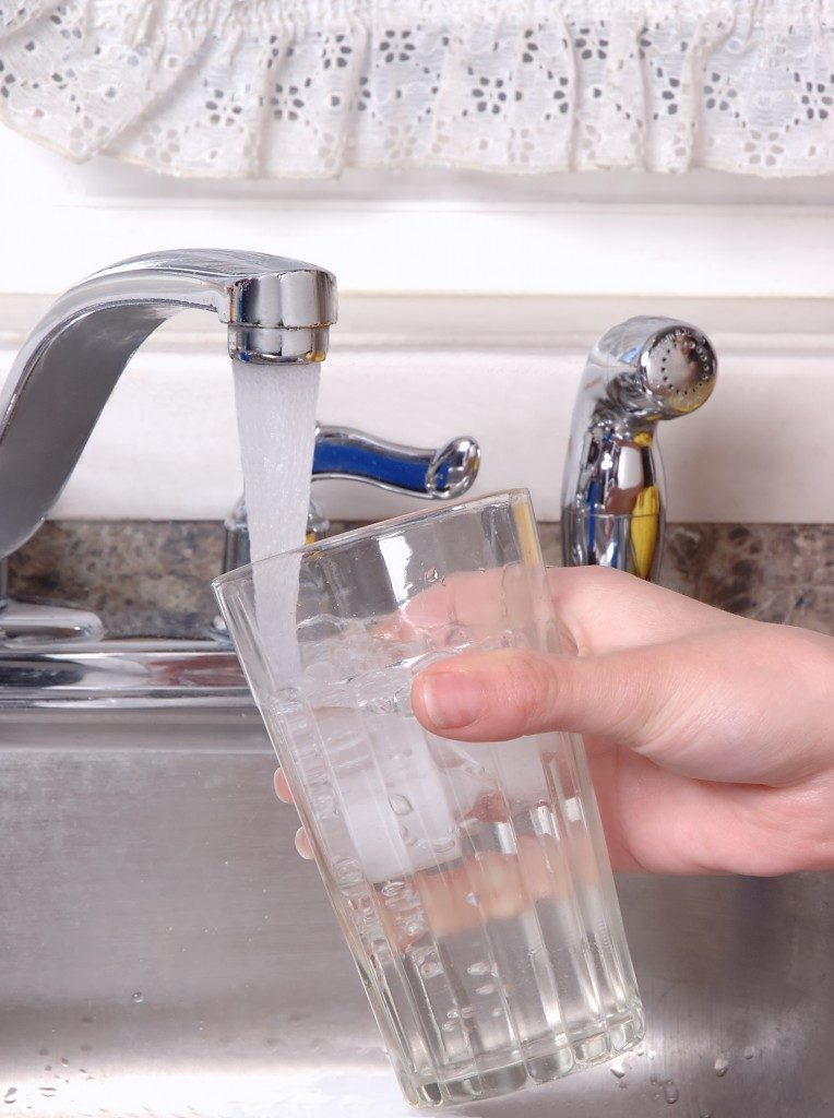 getting water from the tap