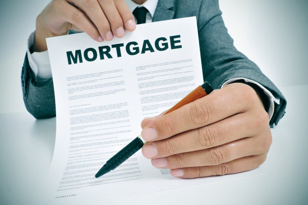 Man showing mortgage contract