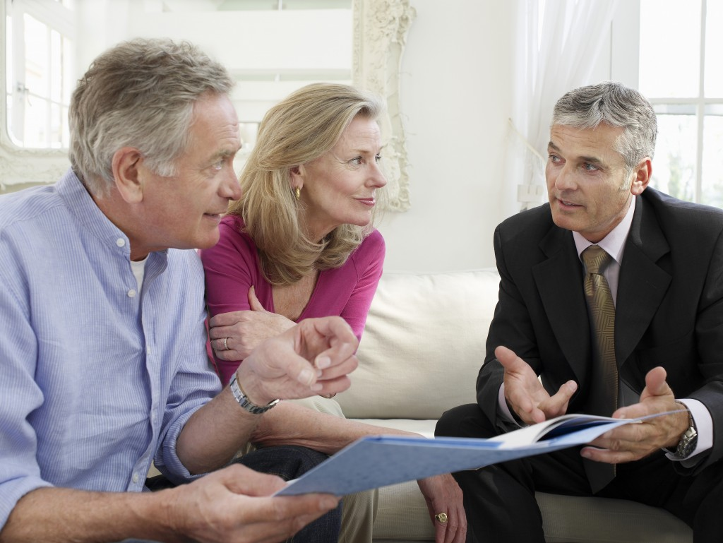 Mature couple talking to a retirement planner