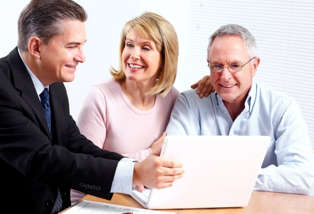 Financial advisor talking to middle-aged clients