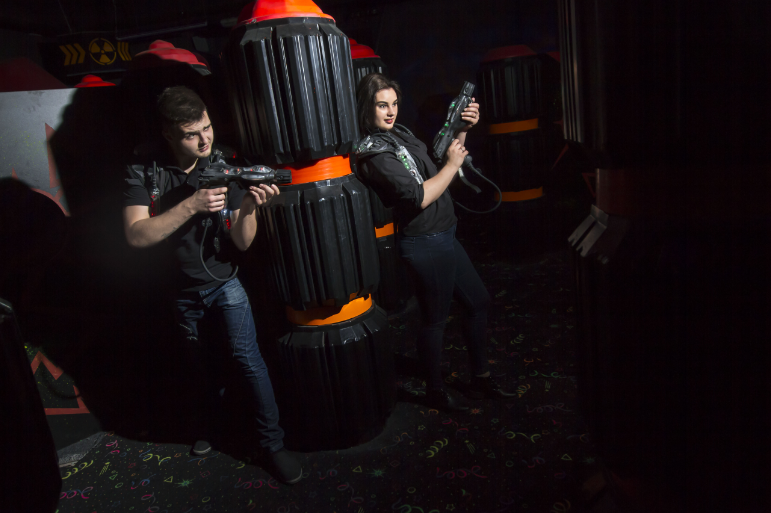 Couple playing laser tag