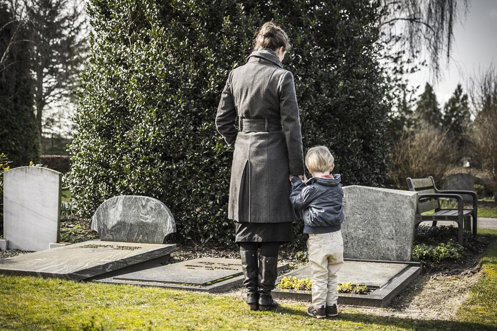 woman and child in graveyard