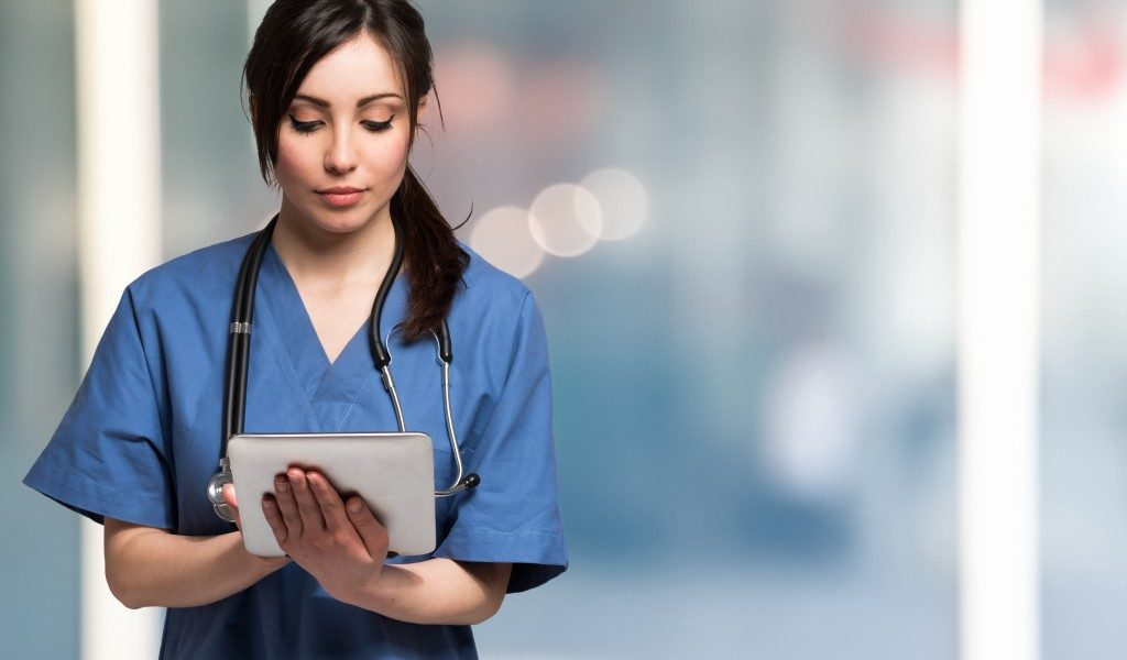 a nurse working on her tablet