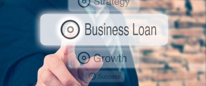 Businessman pressing a Business Loan concept button