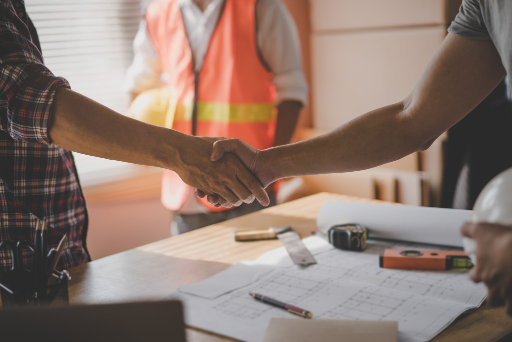 Contractor and client handshake