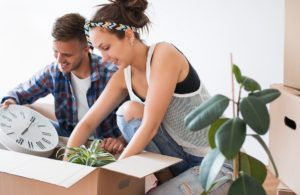 Man and woman packing their items into a box