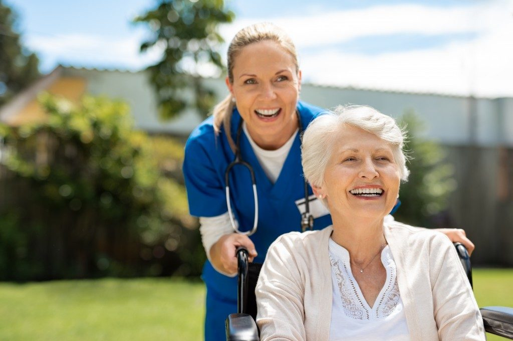 nurse wiith a patient in  the hospital garden