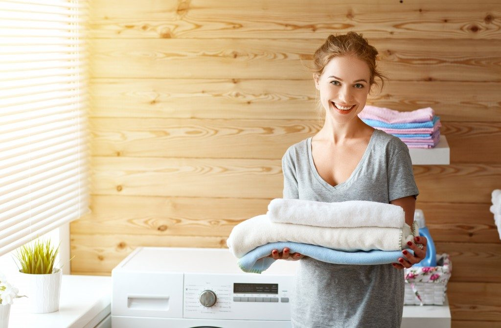 housewife woman in laundry room