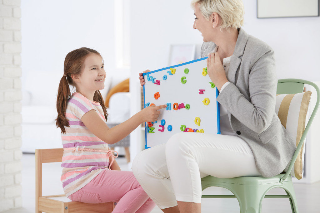 child with teacher